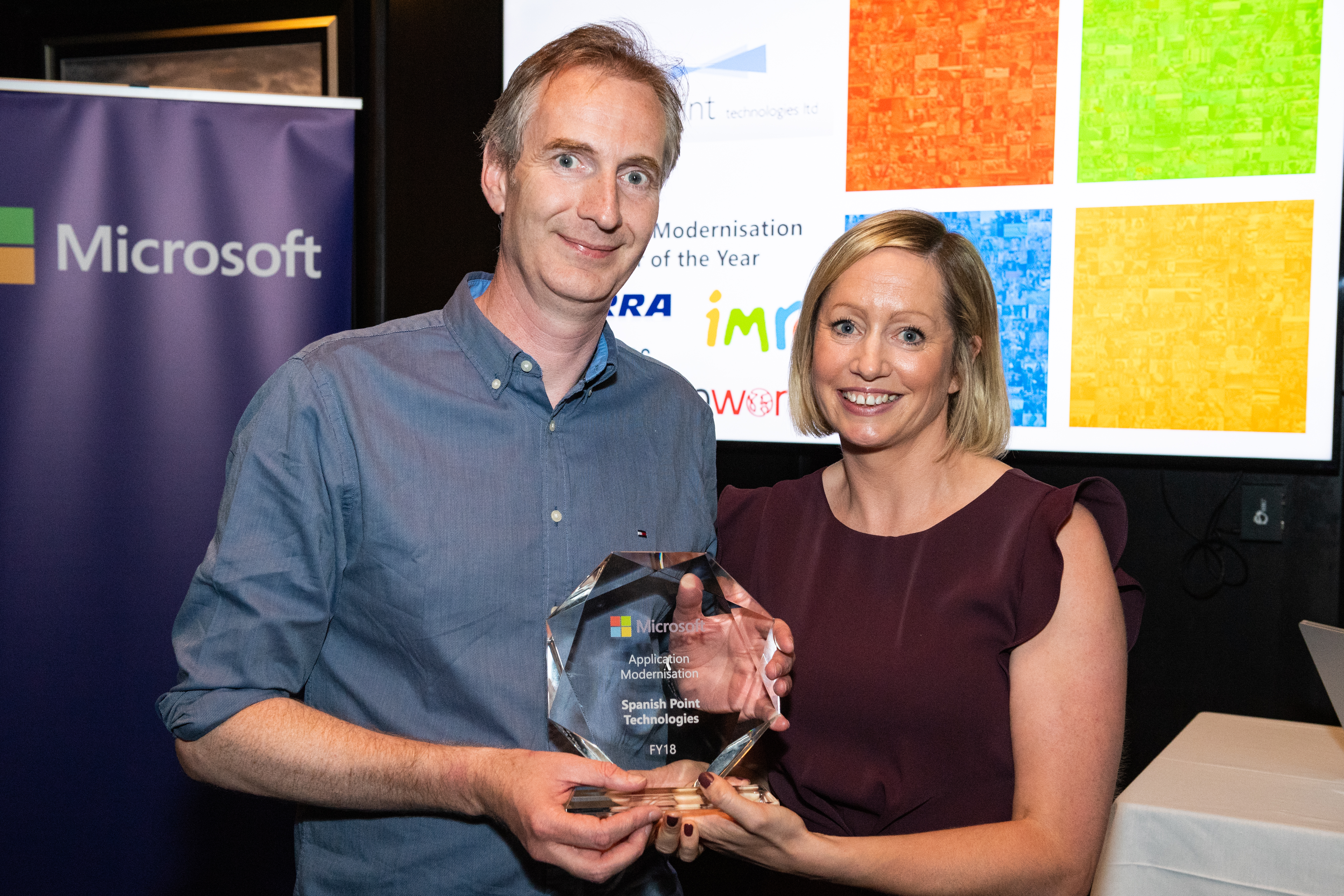 John Corley from Spanish Point receiving an award from Aisling Curtis