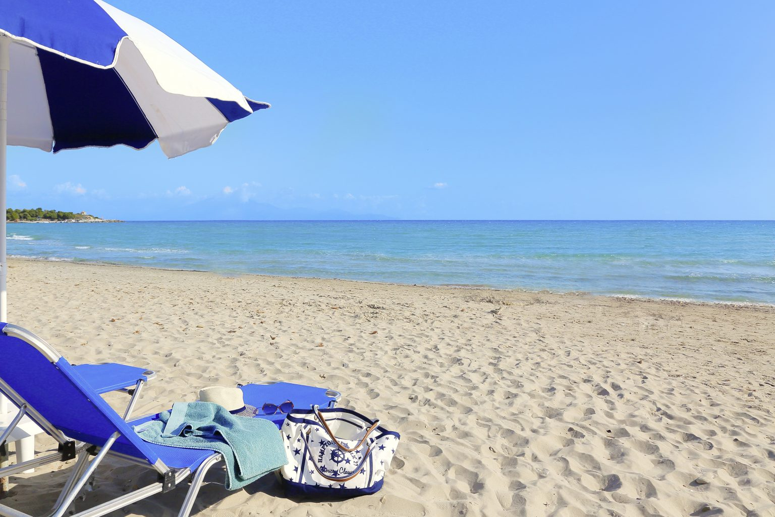 A sunbed and an umbrella overlooking the ocean