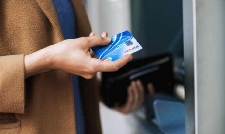 Woman taking a credit card out of a wallet