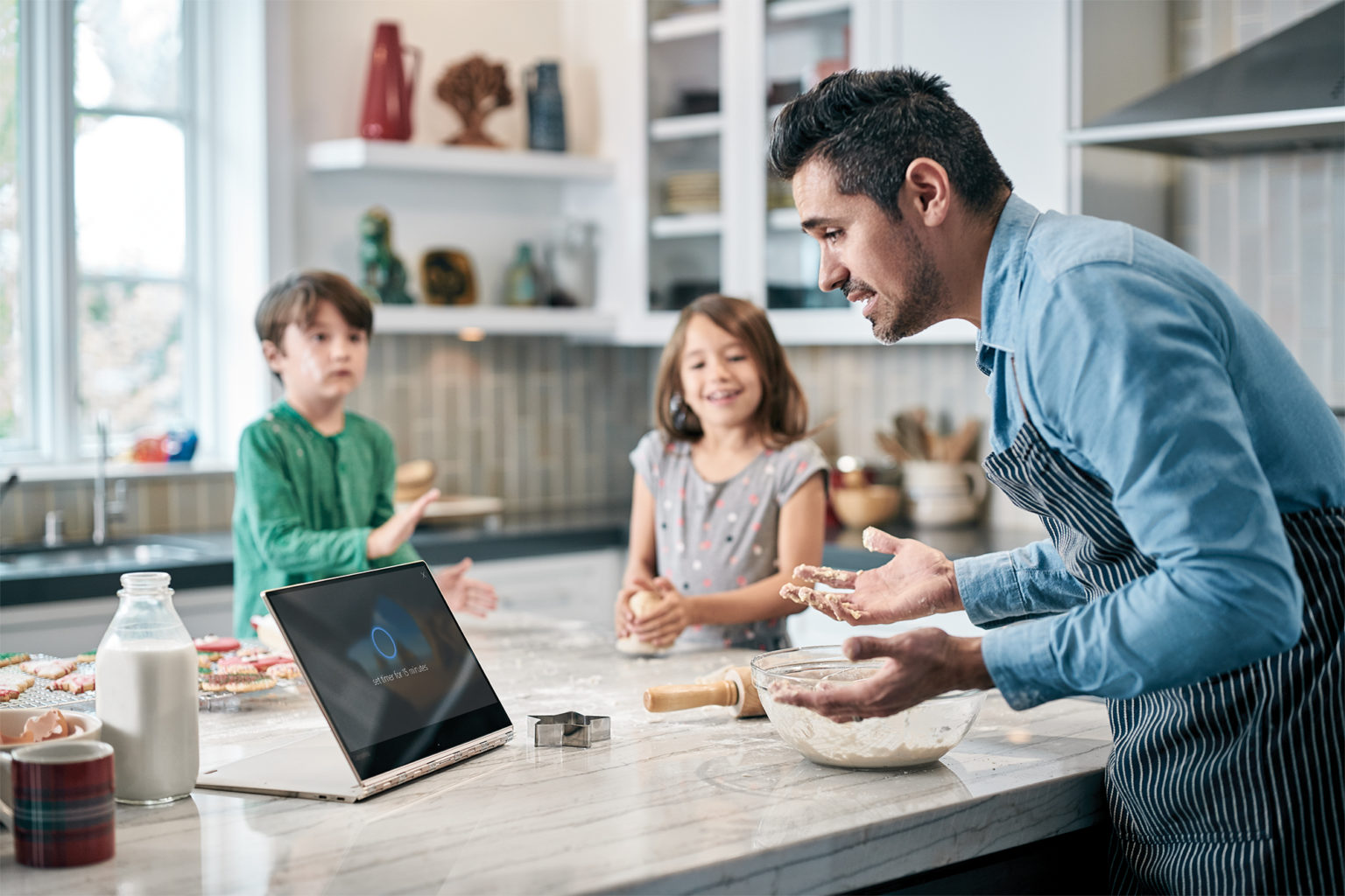 Image of Dad Baking with Kids and Device