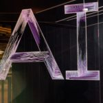 AI spelled in neon letters