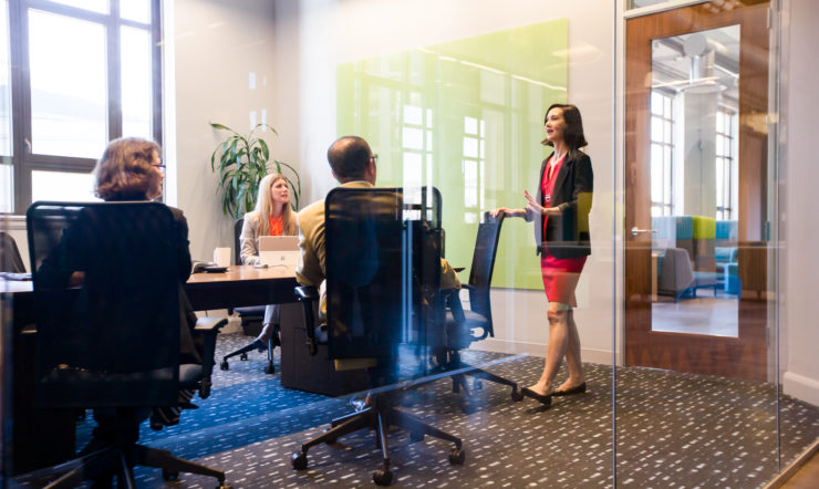 Female CEO leading a business meeting