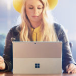 Sofie Lindblom sat with Surface device in boardroom