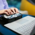 Anne Taylor, a woman who is blind, uses a braille keyboard with a Surface device