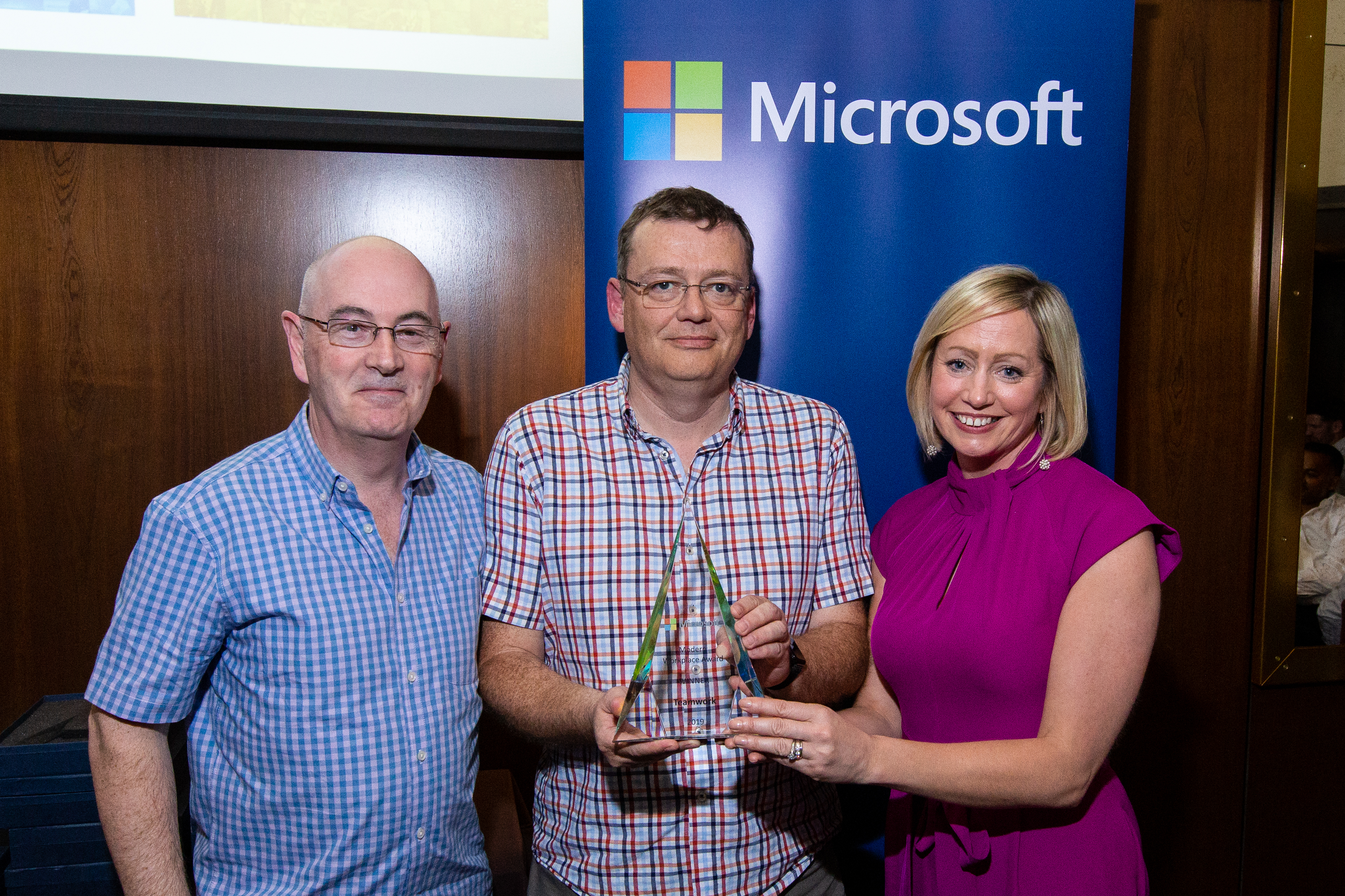 Michael Hutchinson, Operations Director, Nigel Mulholland, Managing Director and Aisling Curtis from Microsoft