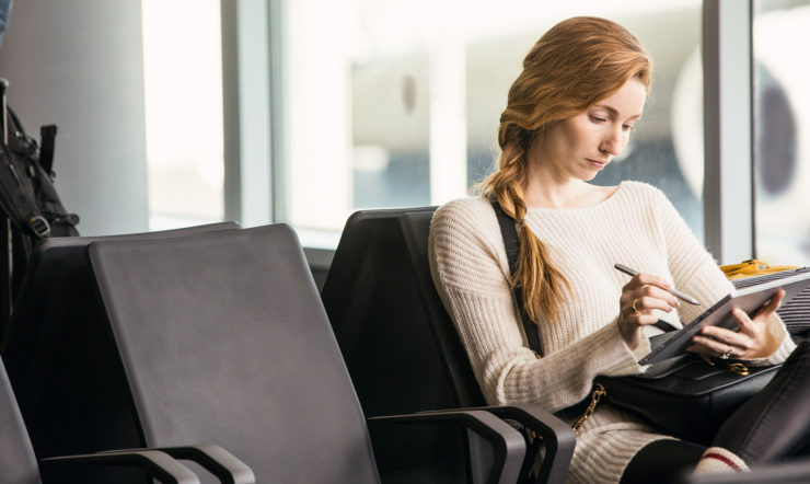SMB employee working remotely from an airport