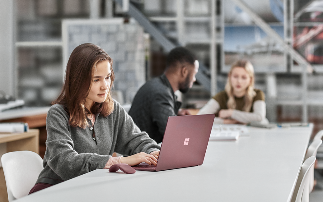 BTS focused student photography in classroom using Surface Laptop