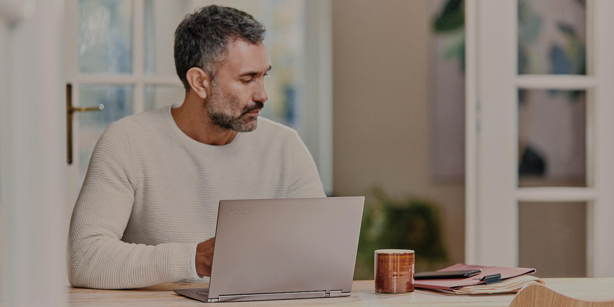 a man standing in front of a laptop computer