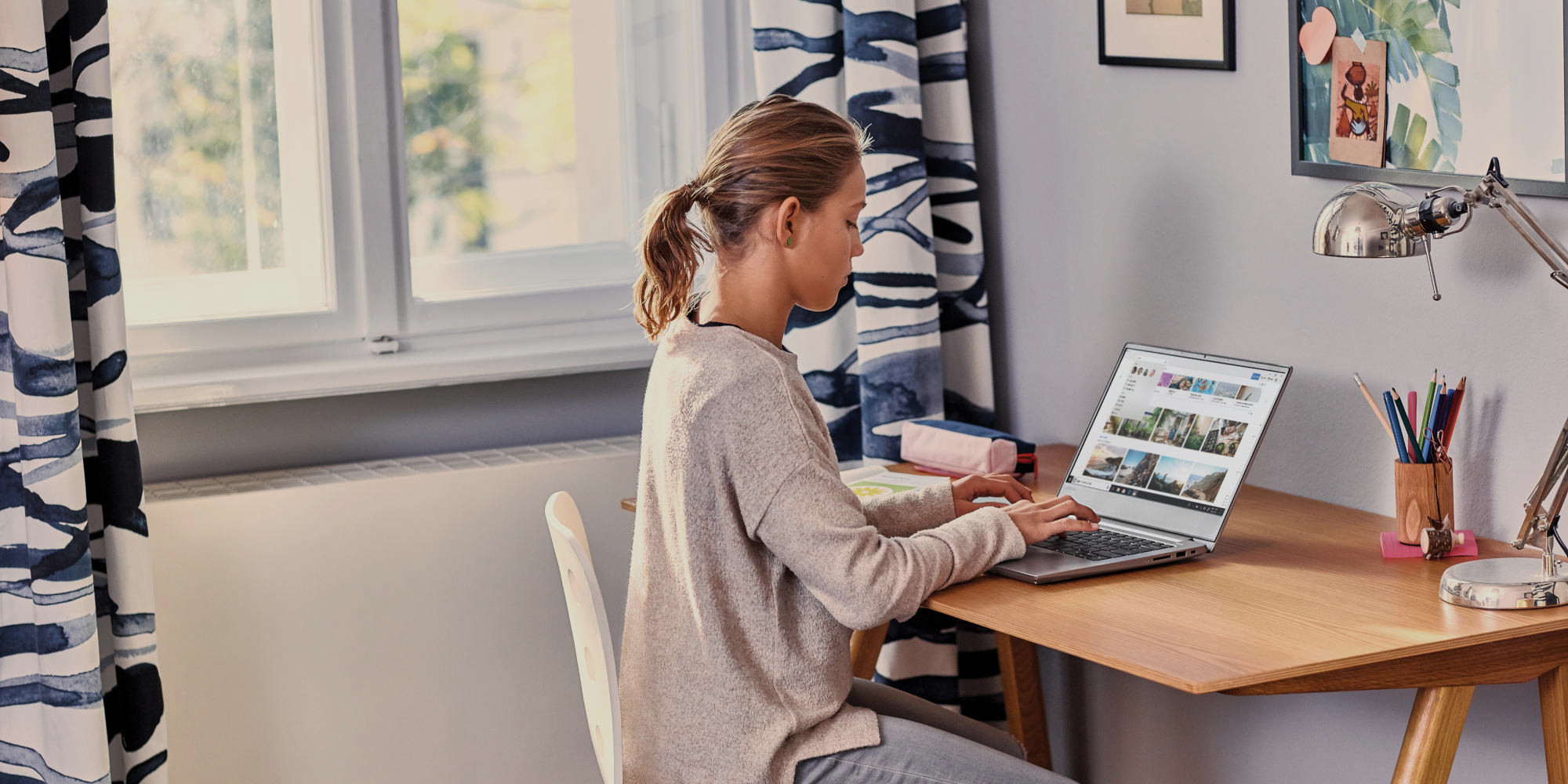 a person sitting at a table using a laptop