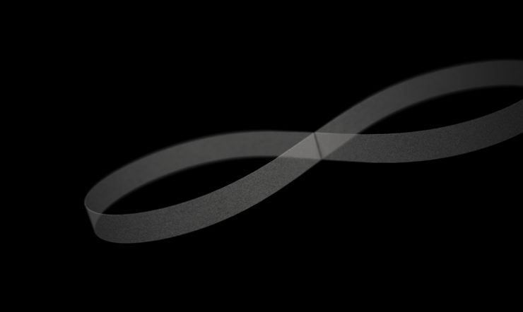 A white infinite loop on a black background, representing the continuous flow of data in a digitally transformed organization