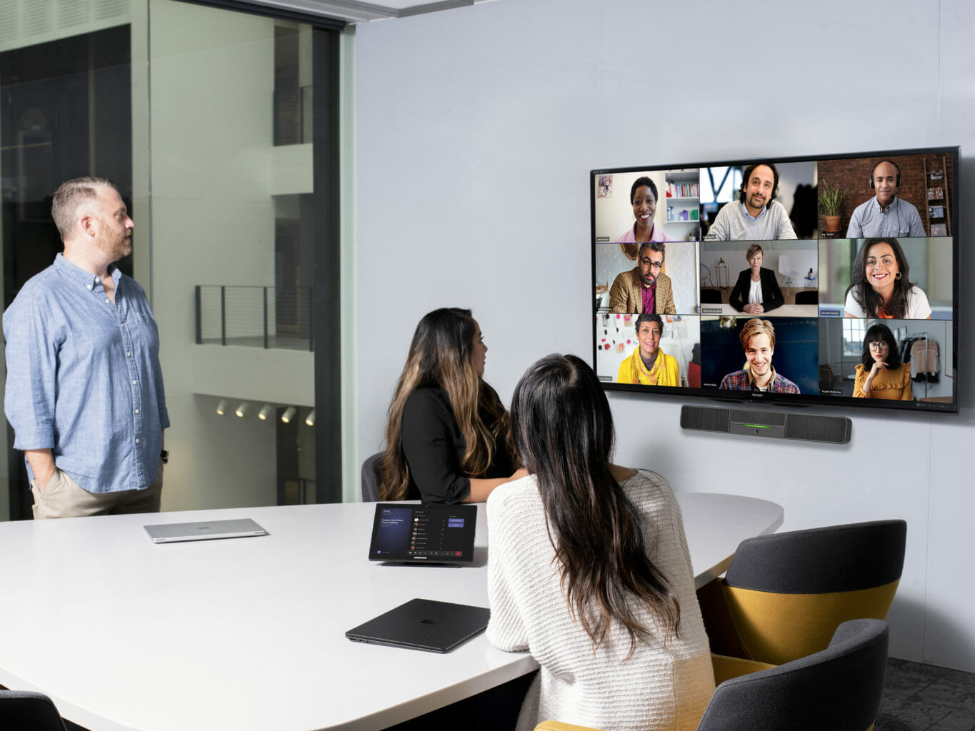 Group of people in a meeting work collaborating with colleagues remotely.