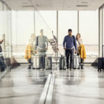 Enterprise team achieving in airport during business travel and mobility.