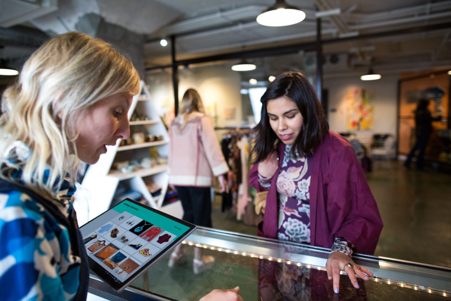 Retail worker helping a customer using a Surface Laptop