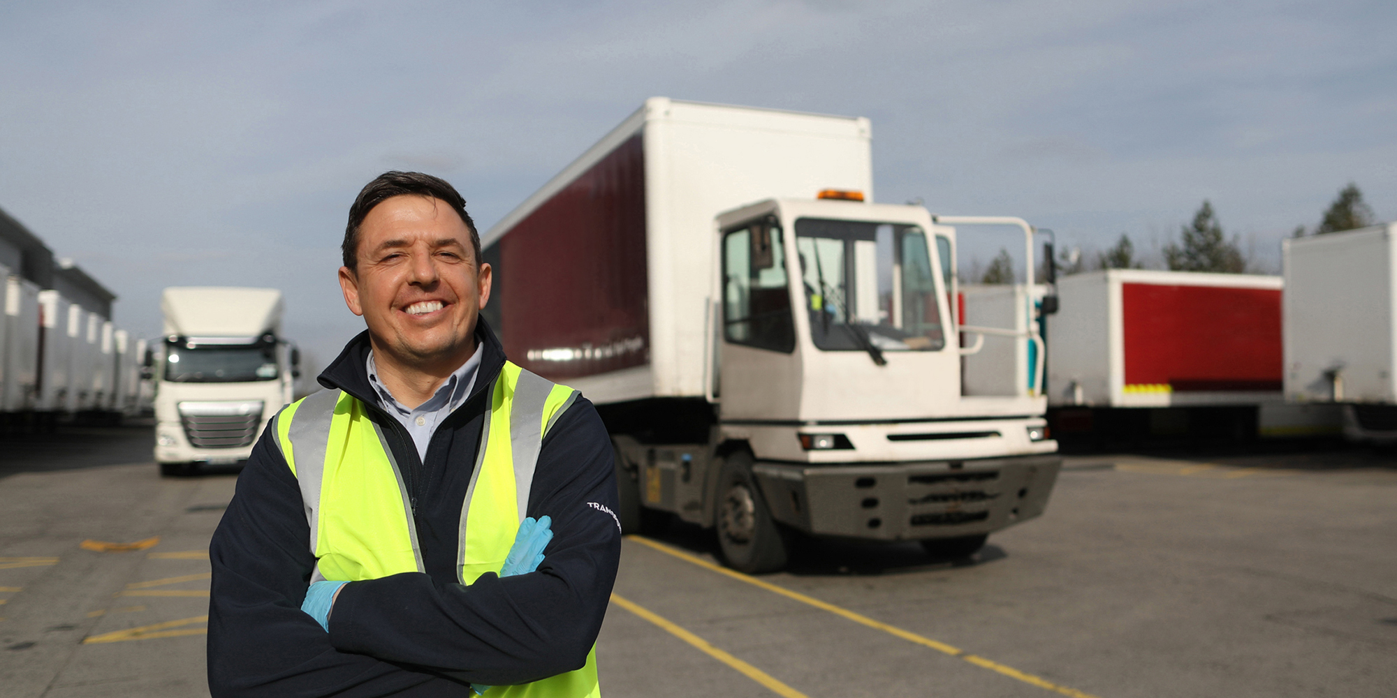 A man standing in front of a truck